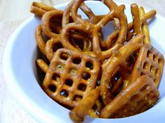 Pin It Beware! These are addictive! Think chex mix meets buffalo party snack and whammy! You've got buffalo pretzels. Homemade Buffalo Pretzels I tried this recipe two ways, once with hot sauce and once with wing sauce. Yes, it does