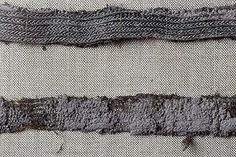 """Textile fragment from Birka grave 886. The Historiska museet labels this as """"tablet weaving"""" (brickvävda), but it looks more like some kind of braided wire trim to me."""