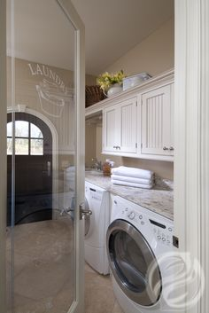 Doing laundry in here is a breeze! With its ample storage, this room can multi-function as a mudroom, craft room, you name it! #GreenfieldCabinetry #CustomCabinetry #LaundryRoom #Laundry #Trend #Cabinets #Image