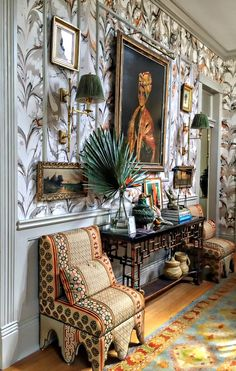 The foyer of The Southern Style Now Showhouse designed by Melissa Rufty. Marblelized wallpaper, layers of eyecatching pattern...
