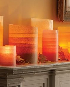 Fall decor - wrap layers of tissue paper around glass jar, add a candle