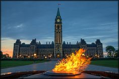 The Centennial flame stands guard in front of Centre Block, House of Commons, Parliament Hill, Ottawa, Ontario, Canada | by Uncle_Greg, via Flickr