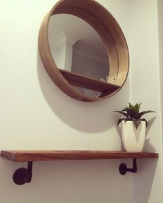 Entrance hall decor. Light industrial diy shelf. Kmart shelf mirror and plant.