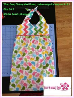Wrap dress with snaps at the bodice for easy on and easy off ! Size 3-4 T