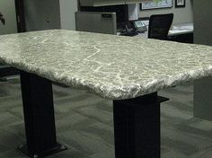 Poured concrete tabletop with caulk veining.