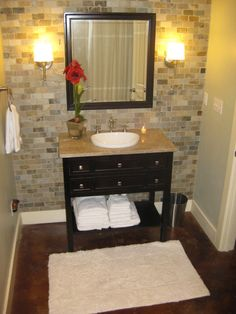 SEE Tile With Dark vanity the white sink POPS                                                        2x1 tumbled brick tile from Lowes, vanity from Sam's. Small bathroom idea