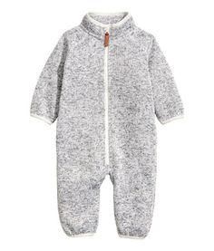 Light gray melange. Jumpsuit in fine-knit, melange thermal fleece with a stand-up collar, zipper at front, and raglan sleeves.