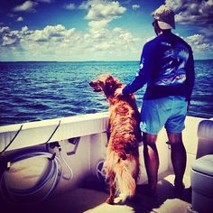Only my three favorite things in the whole wide world: golden retrievers, boats, and hot guys.