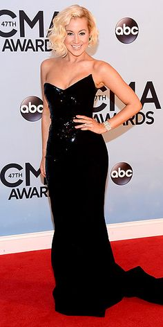 KELLIE PICKLER Wait, is this Nashville or Old Hollywood? The star pulls out all the stops in a va-va-voom black Georges Chakra Couture bustier gown with shimmering details, plus some sophisticated jewels and Veronica Lake waves (if Veronica Lake were growing out her shaved head, that is). Back to CMA Awards 2013