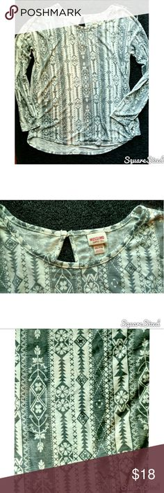 Women's Aztec Long Sleeve Top Women's soft long sleeve Aztec patterned top. Colors are a light oatmeal and gray. Back has a key hole cut out detail with button closure. Super cute for Fall, new without tag. Tops