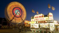 A Ferris wheel lights up the night at the Colorado State Fair - Pueblo, CO