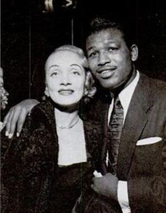 Boxing legend Sugar Ray Robinson with screen legend Marlene Dietrich. Sugar Ray Robinson, Marlene Dietrich, Famous Black Americans, Boxing History, Vintage Black Glamour, Combat Sport, Black And White Background, Old Hollywood, Black History