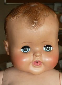 "I have one like this  Madame Alexander Kathy Cry Baby Doll Rubber 20"" Squeaker Drinks Wets 1950's.  Got mine as a 'prize' for getting immunized..smallpox? polio?"