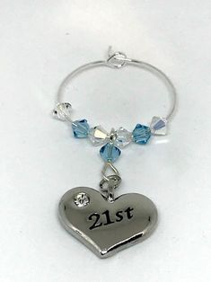 Silver plated heart charm engraved with set with Aquamarine and Clear Swarovski Crystals make this gorgeous wine glass charm Aquamarine is the birthstone colour for March This gift is perfect with a bottle of bubbly. Swarovski Gifts, Swarovski Crystals, Wine Glass Charms, Personalised Gifts, Aqua Marine, Organza Bags, Heart Charm, Birthstones, Silver Plate