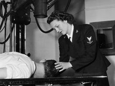 women military ww2   Navy pharmacist's mate Dorothy Abbott adjusts a patient's head ...