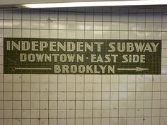 New York City  Subway station '14th Street' IND Sixth Avenue Line  Direction sign at the mezzanine level