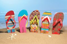 From left: iPANEMA's striped flip-flop with bow detail; Tkees' color-blocked flip-flop with neon thong; Havaianas' Missoni-print flip-flop with contrast strap; Roxy's striped flip-flop with two-color thong; UGG Australia's mosaic-print flip-flop