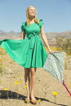 I could walk through fields of flowers all day in a dress like this.   a Cinch Stretch Poplin Fit And Flare Dress Green