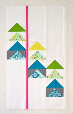 Modern flying geese by Heather/alamode.  I think this would make a cute baby quilt.
