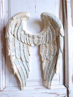Shabby Chic style Angel Wings with a Vintage French Blue and White Distressed Finish These Angel Wings are approx. 12 x 8 1/2 x 2 deep and is made of resin and wood fillers. ORIGINAL DESIGN MADE BY US AND COPYRIGHTED / 2015 - THIS ITEM IS VERY SOLID! NOW AVAILABLE 2018 MATCHING CURTAIN