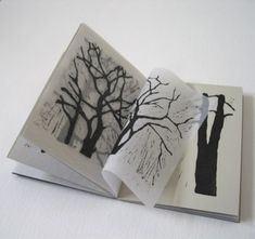 all my neighbours are trees by Sarah Mitchell - original lino cuts printed with black ink on the press for a slight emboss - printed on soft grey BFK Rives paper and translucent acid free tissue so as you turn the pages the silhouettes get bolder or fade away as the paper layers change. Like walking through the forest in the mist...Signed and numbered at the back, one of an edition of 8