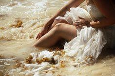 Destination wedding bride on the beach in this trash the dress shoot in the Riviera Maya. Mexico wedding photographers Del Sol Photography. Dress by Maggie Sottero