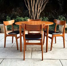 Original $1495 Set of 4 Teak Danish Modern design chairs & dinette round table up for your consideration. This set has clean design lines. The