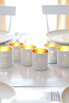 Tin-punched candle holders— they're practically free to make and make a great centerpiece!