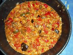 Recette de Tchoutchouka aubergine,poivron et oeufs