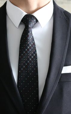 Lord Wallington Ties http://lordwallington.com/product/black-geometric-dot-tie/