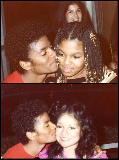 Big brother love!! Michael Jackson kissing sisters Janet & LaToya.