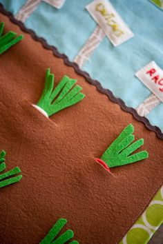 cute for preschool - felt vegetable patch  (but make the stems a stronger material so it won't rip from being grabbed and pulled out over time)