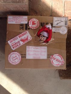 """Madison's first elf on the shelf. Introductory Elf ~ escaping the box. Day 1. Inside the box: the wrapped elf box with book, elf, and a personalized letter from Santa explaining the """"rules""""."""