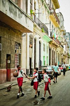 Cuba..all children are required to wear uniforms..many uniforms are passed down and given by the government..also told what to study