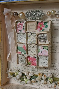 I like the garland at the top made out of recycled jewelry...great idea for shadow box.