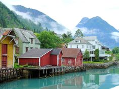 Welcome to Fjærland, Norway, one of the most charming and picturesque ports in Norway. The Fjordstuer Hotel can be seen in the background.