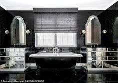 Magical in monochrome: Two vanity mirrors will no doubt have helped Kylie perfectly contou...