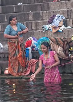 Want to Travel to India? Here's What You Should Know Local women bathing in the Ganges and setting candle wishes in the water