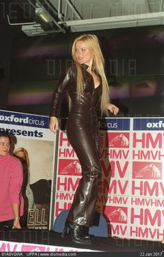 Geri Halliwell wraps her Curves in a snug fitting black faux Leather Catsuit Leather Catsuit, Leather Jumpsuit, Leather Pants, Long Leather Skirt, Leather Dresses, Pop Singers, Female Singers, Rubber Catsuit, Hobble Skirt