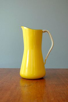 Jens Quistgaard; Enameled Steel and Plastic Cord 'Kobenstyle' Pitcher for Dansk, 1956.