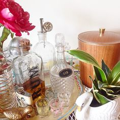 Vintage barware bar cart styling. #peoni #swan #planter #thrifted