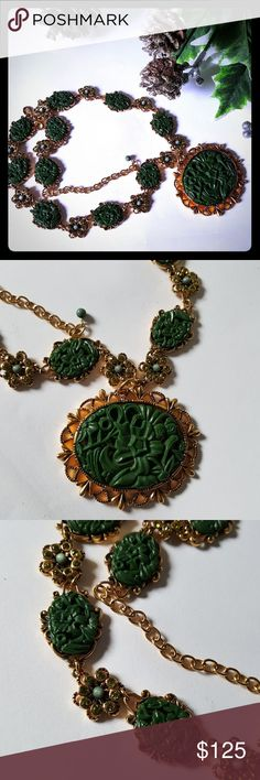 Gorgeous Joan Rivers Celluloid Necklace This is a very pretty Joan Rivers Vintage Statement Piece. It is goldtone and has carved celluloid with flowers. Enhanced with green rhinestones and a blue pearl like bead to make flowers. In excellent vintage condition. May include some wear due to this being a vintage item. Sold as is. Vintage Jewelry Necklaces