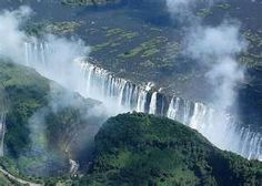 Victoria Falls between Zambia and Zimbabwe Places Around The World, Oh The Places You'll Go, Travel Around The World, Places To Travel, Largest Waterfall, Victoria Falls, Beautiful Waterfalls, Africa Travel, Amazing Nature