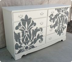 Damask Stencil + Paint = updated dresser!  @Sarah Aranda you must have something hiding in your garage you can do this to!