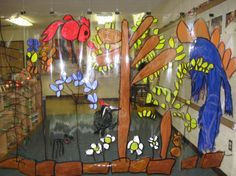Forest Mural.... Mural composed and created by enlarging several children's drawings onto a large piece of plastic using an overhead projector. Teacher traced the outlines for the children used their original drawings as a plan to paint in the colors! Awesome!!