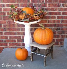 Fall Decorating Tip - Use what you have to decorate. An unused bird bath makes a great fall pedestal. Have an outdated fall wreath that you no longer hang on your door? Lay it on top of the bird bath and place your pumpkin in the middle. Easy and cute!