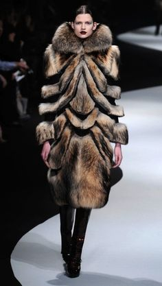 Viktor & Rolf. Poor animals were killed to make this bloody disgustingly ugly coat!!