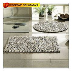 cut out a shape from a piece of scrap carpet, glue on pebbles, purchased from a Nursery, to create a bath mat.