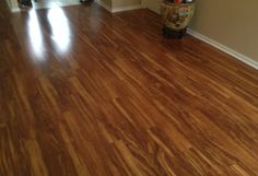 Living Room, PERGO XP in Hawaiian Curly Koa #PERGO #ConceptualTileSolutions #WoodLaminant