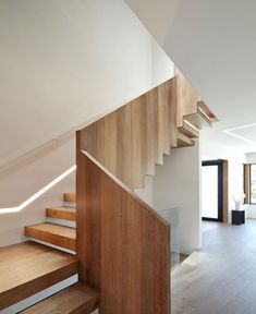 Central Stair at Living/Dining level. Tagged: Staircase, Wood Railing, and Wood Tread. Noe Valley House by IwamotoScott Architecture. Browse inspirational photos of modern staircases. Basement Staircase, Modern Staircase, Staircase Design, Stairs Joinery, Stair Handrail, Wood Railing, Hillside House, San Francisco Houses, Entrance Ways